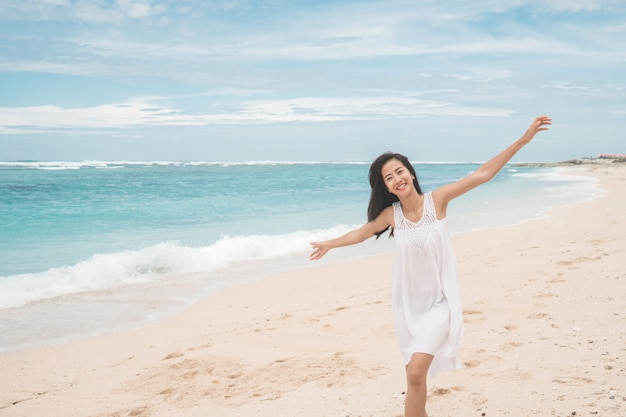 Excited woman on the beach