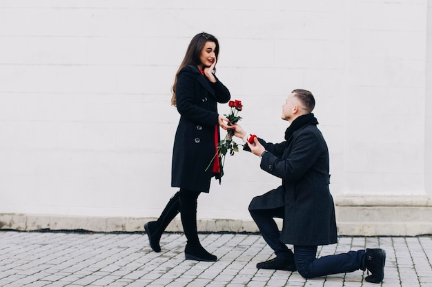 Excited woman being proposed on street