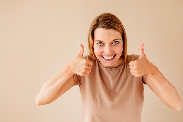 Excited woman gesturing thumb up