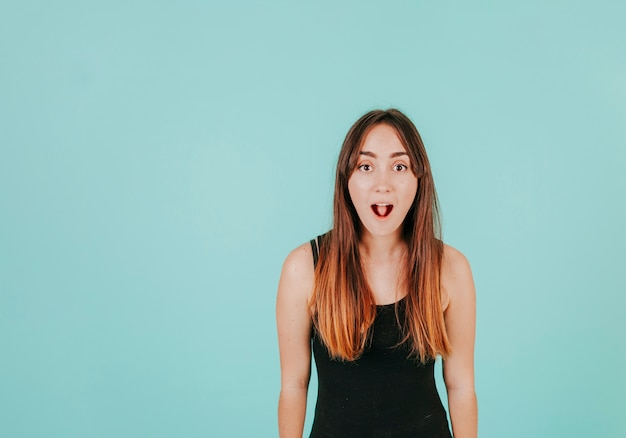 Excited woman looking at camera