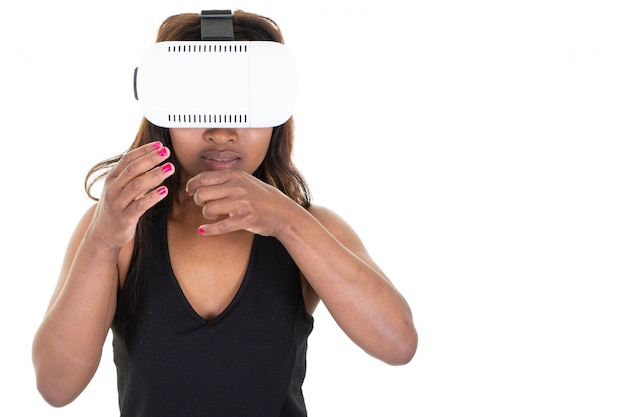 Excited woman playing a video game in virtual reality spinning head in vr