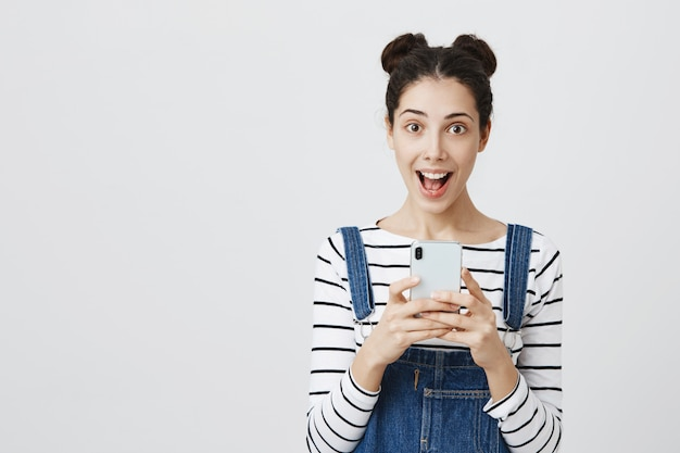 Excited woman receive good news on smartphone