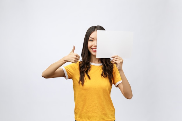 Excited woman thumbs up with blank poster sign
