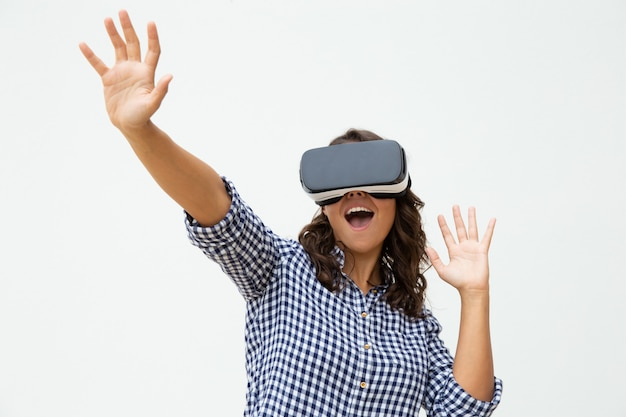 Excited woman using vr headset