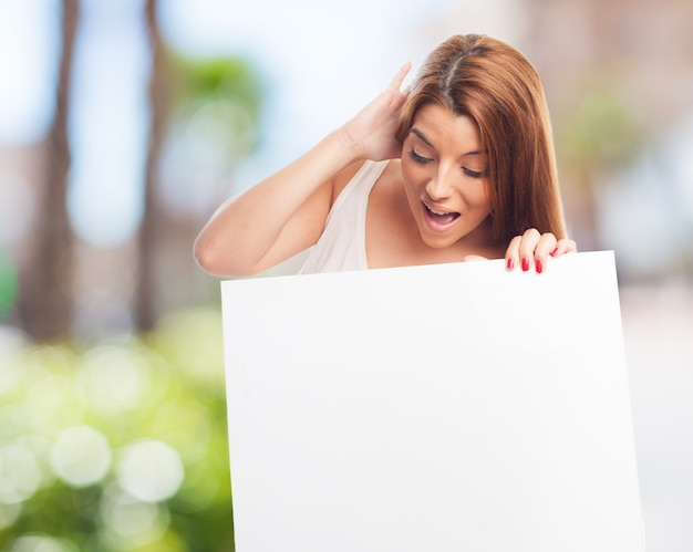 Excited woman with blank placard