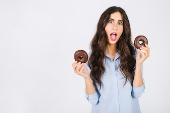 Excited woman with donuts