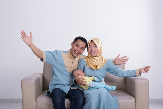 Excited young asian muslim family