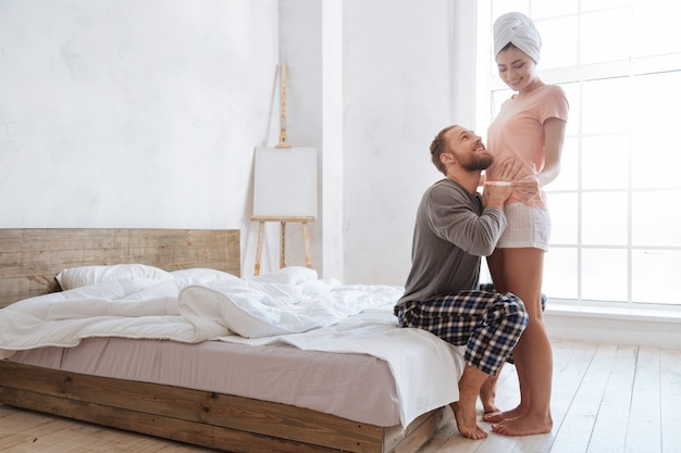 Excited young couple cannot keep its real emotions inside after seeing positive pregnancy test results