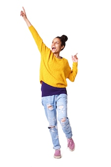 Excited young woman standing with her arms up