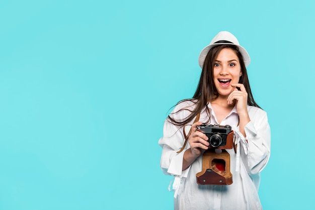 Excited young woman with camera