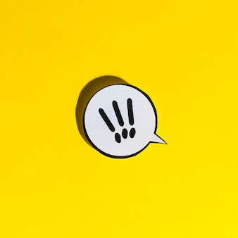 Exclamation mark icon speech bubble on yellow backdrop
