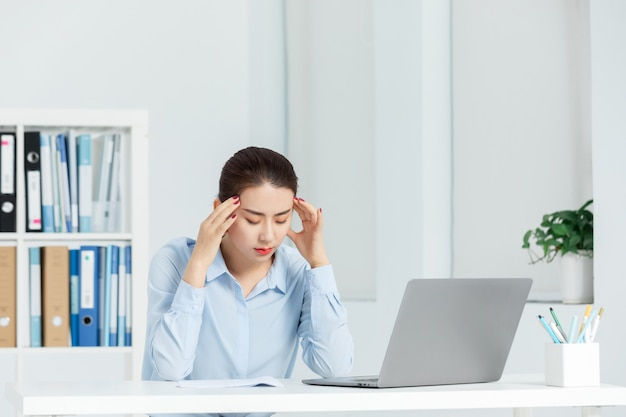 Executive business women feel headaches in the office