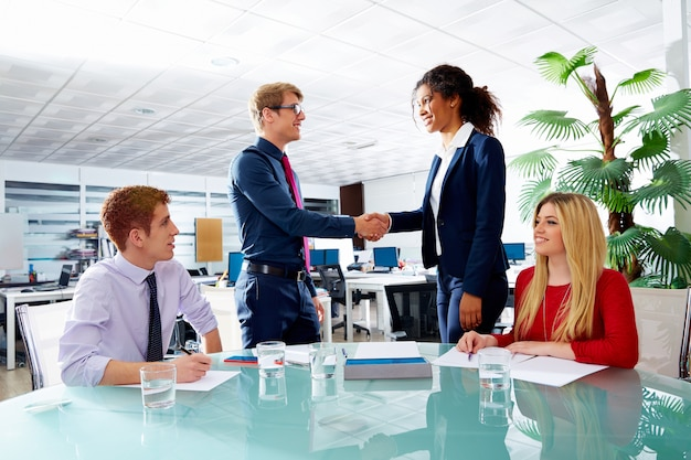 Executive handshake business people at meeting
