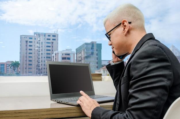 Executive man checking computer near window
