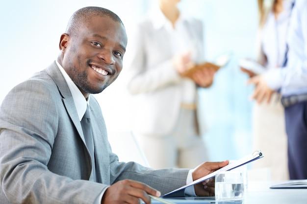 Executive reviewing notes