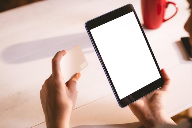 Executive using digital tablet
