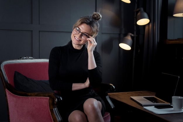 Executive young woman with eyeglasses posing