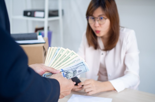 Executives providing salary for young asian staff. receiving annual bonuses for salaried employees