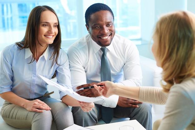 Executives reviewing a contract