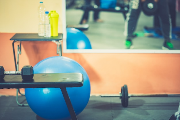 Exercise weight training fitness on dumbbells