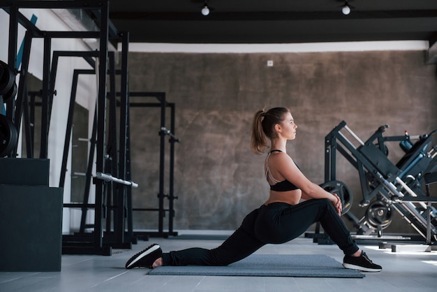 Exercises for buttocks.  gorgeous blonde woman in the gym at her weekend time.
