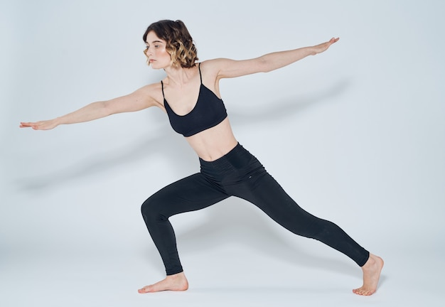 Exercises slim woman yoga asana light wall meditation model