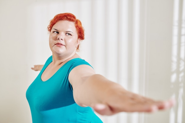 Exercising plus size woman