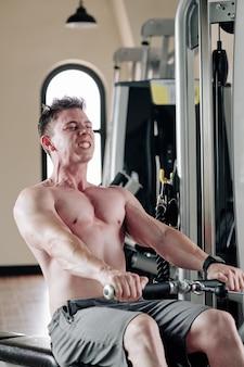 Exercising in rowing machine