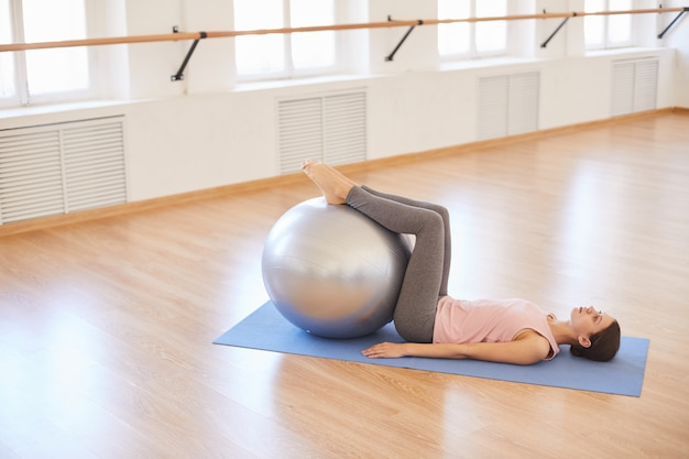Exercising with swiss ball