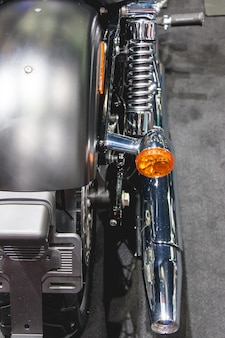 Exhaust pipe and back turning orange light bulb