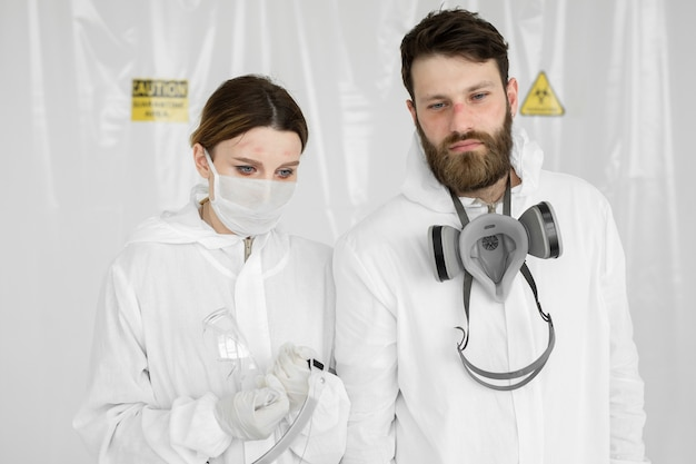 Exhausted doctors or nurses taking of protective mask uniform