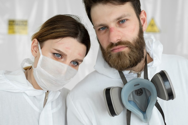 Exhausted doctors or nurses taking of protective mask uniform.