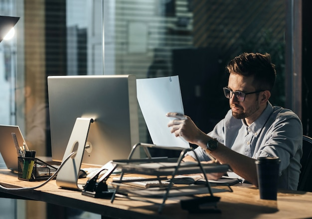 Exhausted man with papers overworking