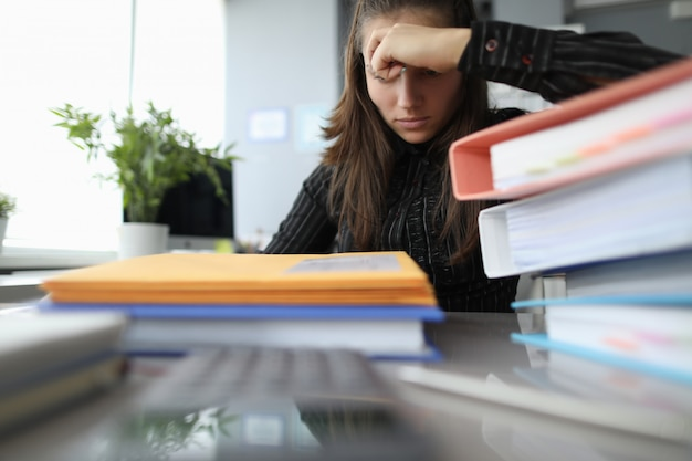 Exhausted woman busy with work