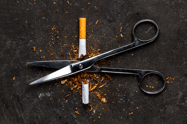 The  of an exit from nicotine addiction. man throws a harmful, and unhealthy habit. stop smoking.