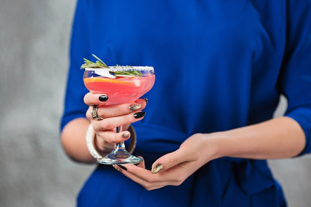 Exotic cocktail and female hands