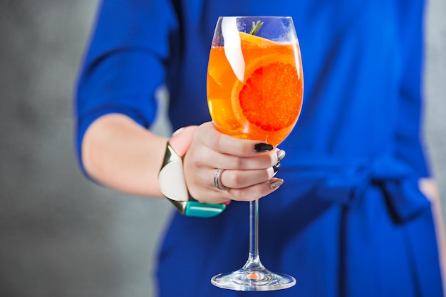 The exotic cocktail and female hands