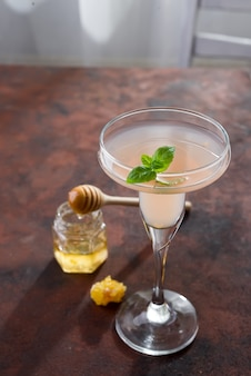 Exotic cocktail, honey on brown stone background , copy space