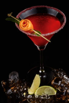 Exotic cocktail with rose closeup