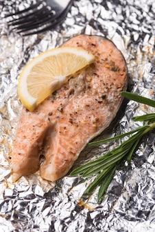 Exotic cut slice of seafood salmon on aluminium foil