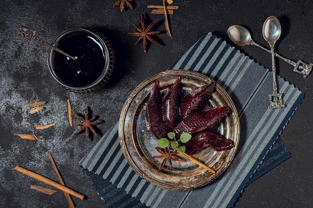 Exotic dessert and black tea on table