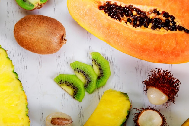 Exotic fruits on a the summer tropical composition papaya, kumquat