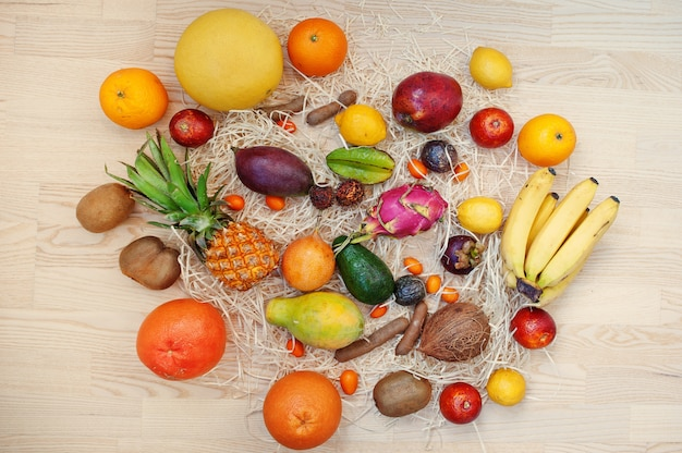 Exotic fruits on wooden background.
