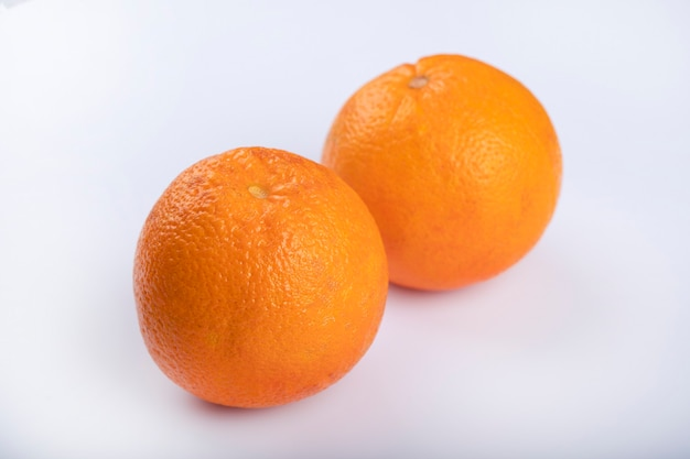 Exotic juicy orange fruits isolated on white background.