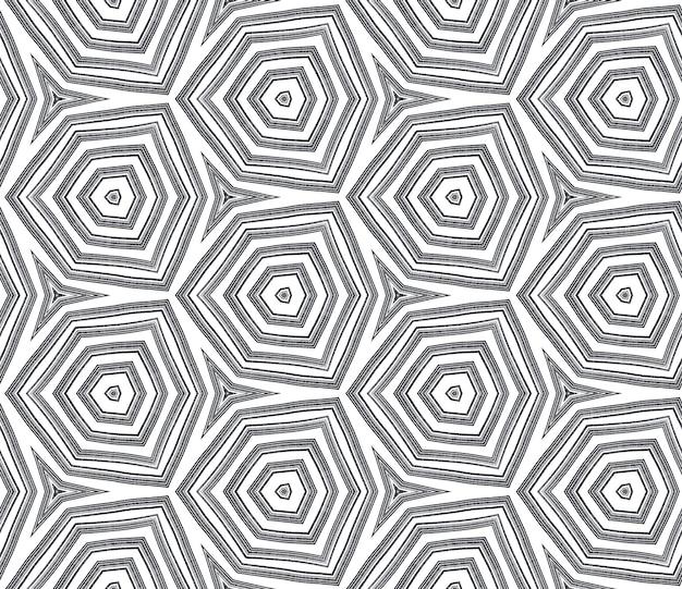 Экзотический бесшовный образец. черный симметричный фон калейдоскопа. текстиль готов изумительный принт, ткань купальников, обои, упаковка. летние купальники экзотического бесшовного дизайна.