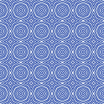 エキゾチックなシームレスパターン。インディゴ対称万華鏡の背景。テキスタイルレディの美しいプリント、水着生地、壁紙、ラッピング。夏の水着エキゾチックなシームレスデザイン。