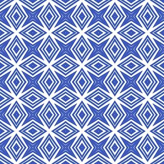 エキゾチックなシームレスパターン。インディゴ対称万華鏡の背景。テキスタイルレディメスメリックプリント、水着生地、壁紙、ラッピング。夏の水着エキゾチックなシームレスデザイン。