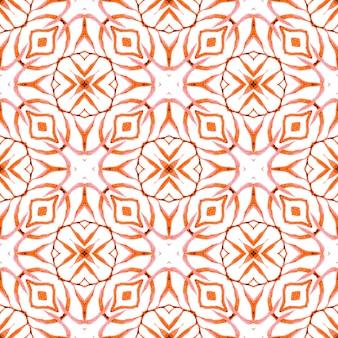 エキゾチックなシームレスパターン。オレンジ色の魅力的な自由奔放に生きるシックな夏のデザイン。テキスタイル対応の理想的なプリント、水着生地、壁紙、ラッピング。夏のエキゾチックなシームレスボーダー。