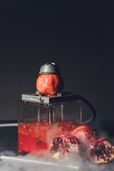 Exotic smoking shisha in east style with tobacco aroma of pomegranate. fruit hookah.