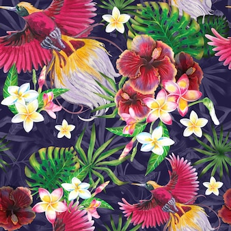 Exotic summer background with paradise bird, tropical leaves and hibiscus flowers.